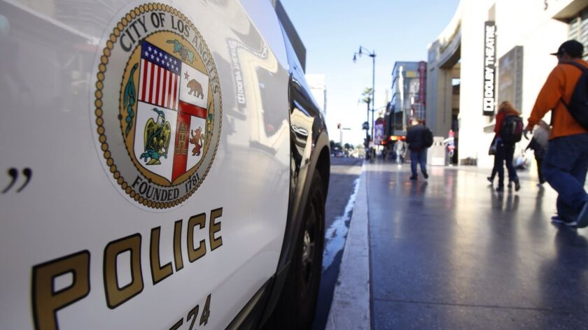 HOLLYWOOD, CA JANUARY 7, 2015 -- An LAPD cruiser sits parked at Hollywood and Highland near the sce