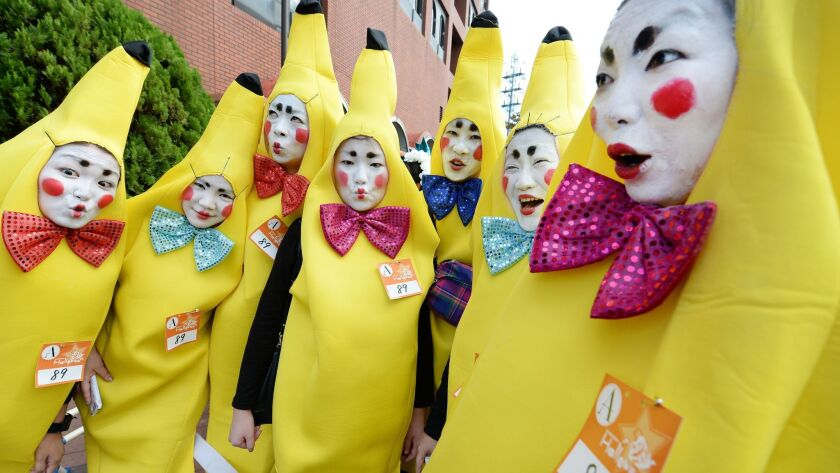 Participants wear costumes as they pose for pictures before the Halloween Parade in Kawasaki, a subu