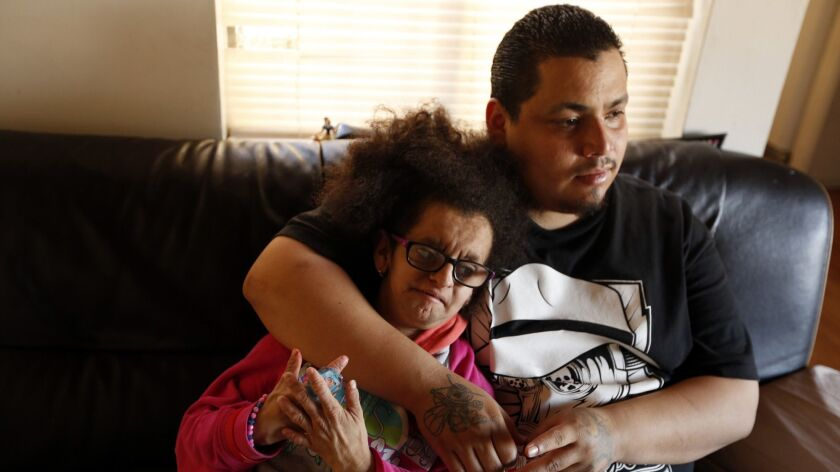 Jesus Arreola Robles, then 22, spends time with his sister, Maria Lupita Arreola, then 16, who has the accelerated aging disorder progeria, in their family's North Hollywood apartment on March 15, 2017.