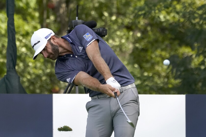 Dustin Johnson hits his tee shot on the 16th hole during the third round at the BMW Championship on  Aug. 29, 2020.