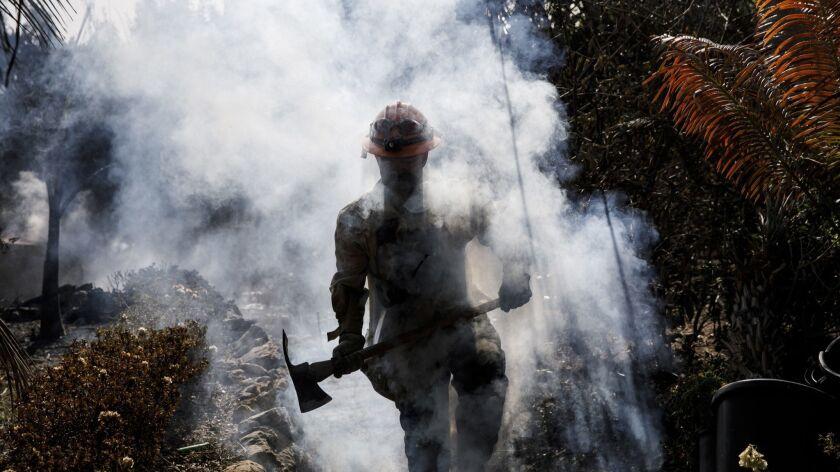 L.A. County firefighter Capt. Victor Correa works on the Woolsey fire in Malibu.