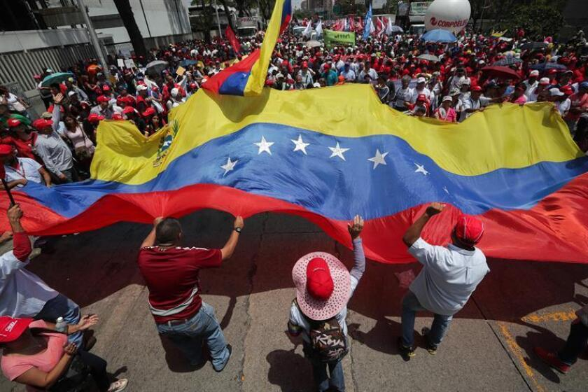 "Thousands of Chavistas march through Caracas this Saturday, March 16, 2019, to condemn the recent ""cyberattack,"" which they claim was the work of the US and the opposition, and which hit the main hydroelectric plant in the country, Guri, and left almost all of Venezuela without electricity for five days. EFE-EPA/Rayner Peña"