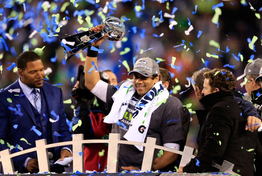 Russell Wilson of the Seattle Seahawks celebrates with the Vince Lombardi trophy.