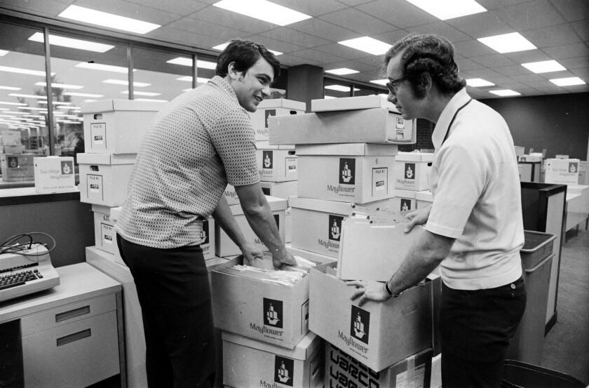 1973: Evening Tribune reporters Nick Canepa and Mark Monday unpacking in the Tribune newsroom.
