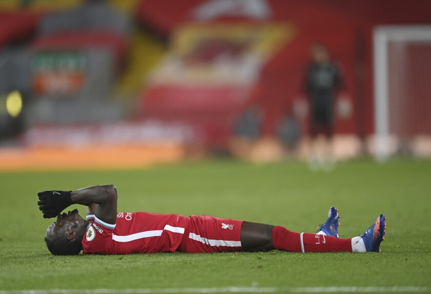 Liverpool's Sadio Mane lies on the field during the English Premier League soccer match between Liverpool and Chelsea at Anfield stadium in Liverpool, England, Thursday, March 4, 2021. (Laurence Griffiths, Pool via AP)