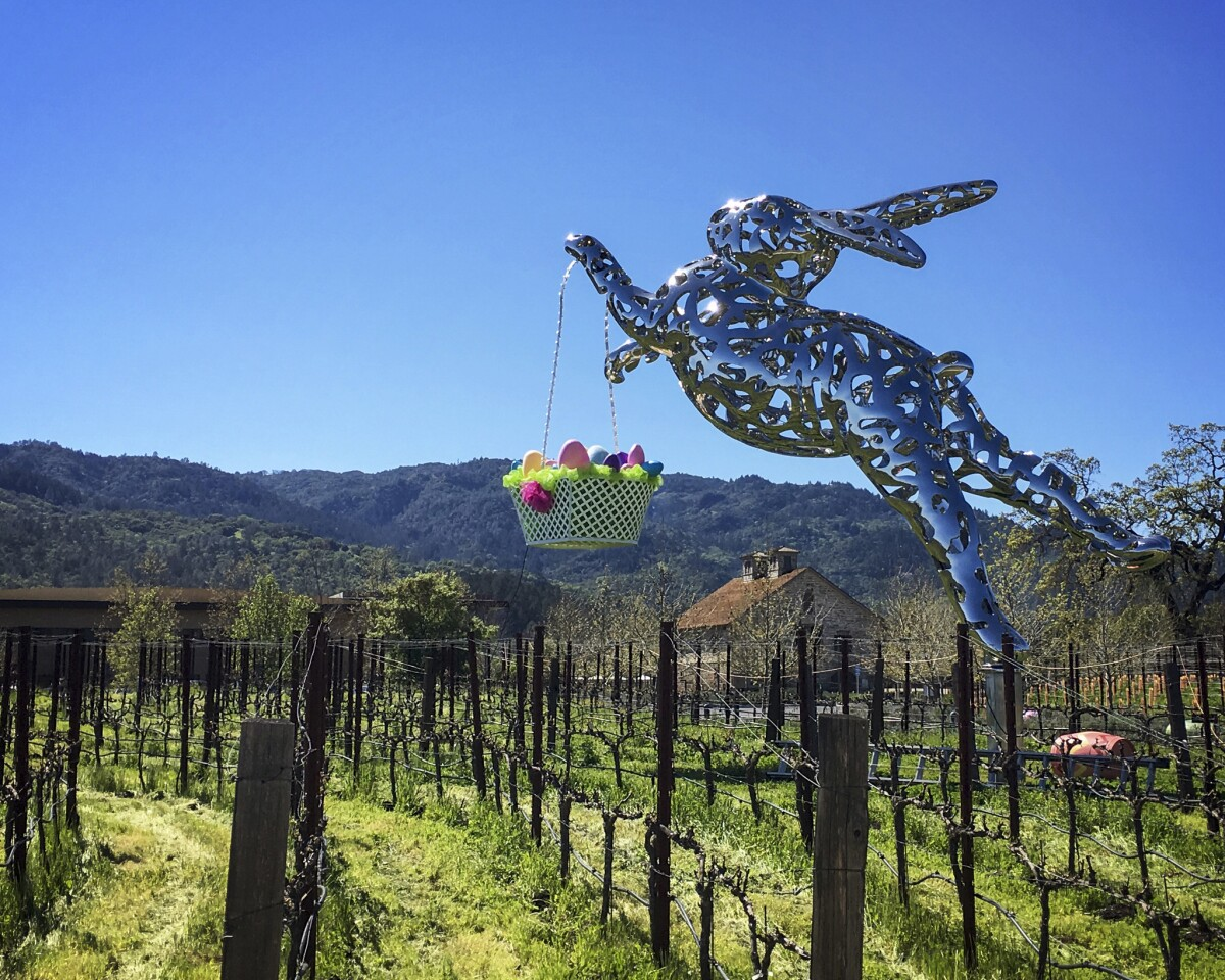 """Lawrence Argent's """"Bunny Foo Foo"""" is a 35-foot stainless steel sculpture at Hall Wines vineyards in St. Helena. The rabbit gets dressed up for Christmas and Easter (with a basket of eggs on its arm) but pretty much can just be seen leaping over the vineyards any old time."""