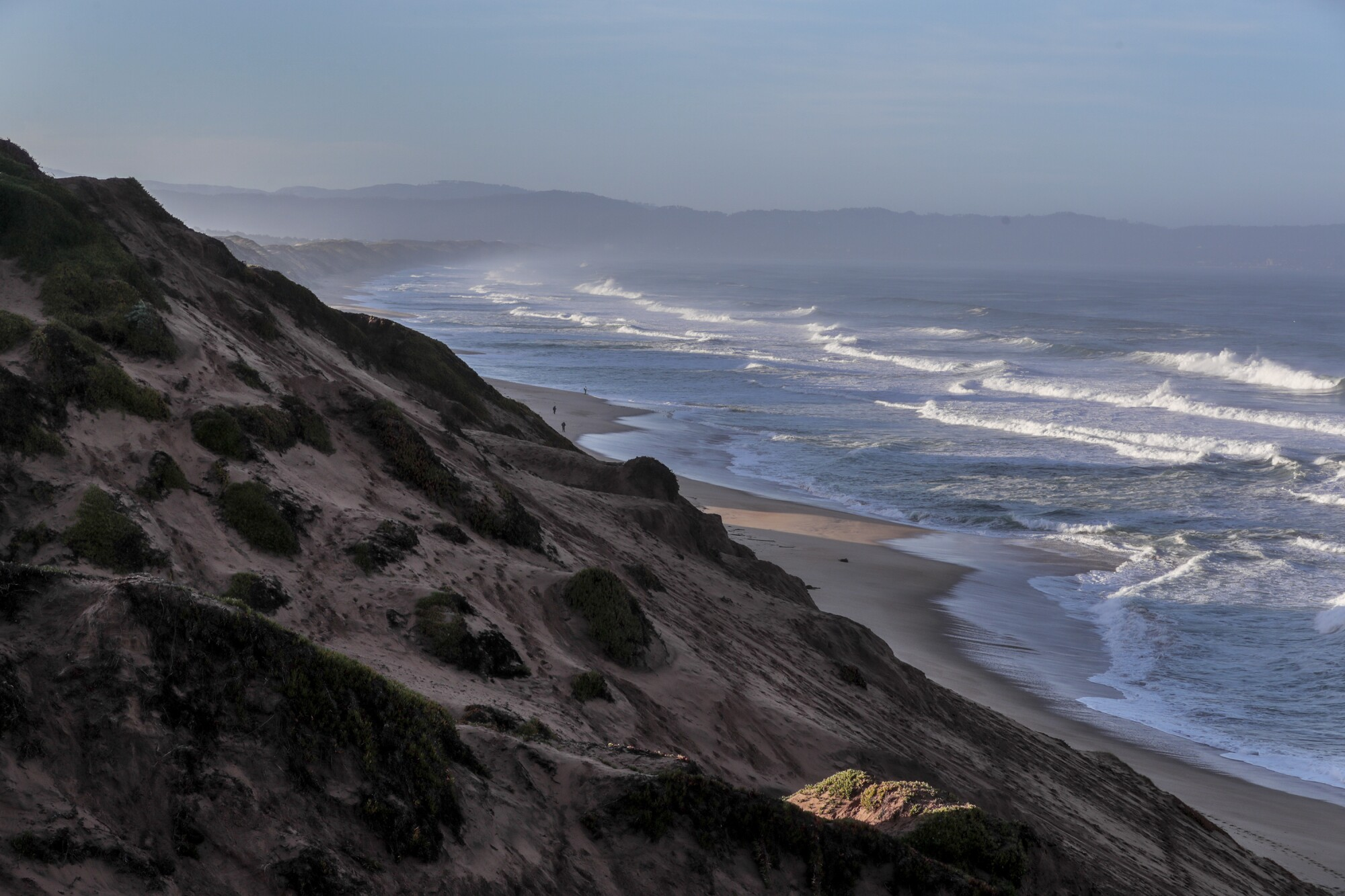 Sea level rise and coastal erosion threaten the beaches and natural sand dunes in Marina, Calif.
