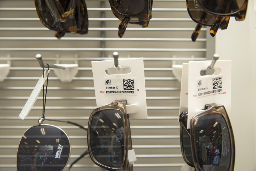 Radio frequency identification tags are displayed on sunglasses, Thursday, Jan. 26, 2017, at a Target store in Oak Lawn. The radio frequency identifications tags, or RFID, help the retailer better locate and track items within their inventory. These tags shown are tags that were manually placed on items throughout the store.