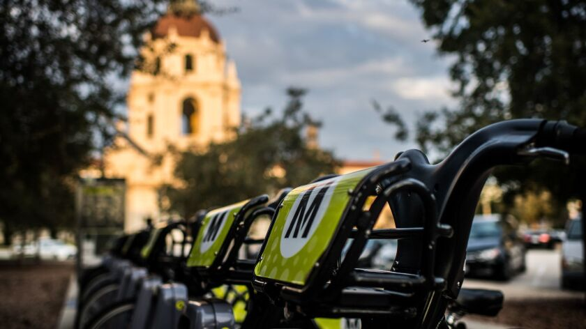 PASADENA, CA - July 30, 2018 Metro bikes rest at their bike-share station outside City Hall in Pasad