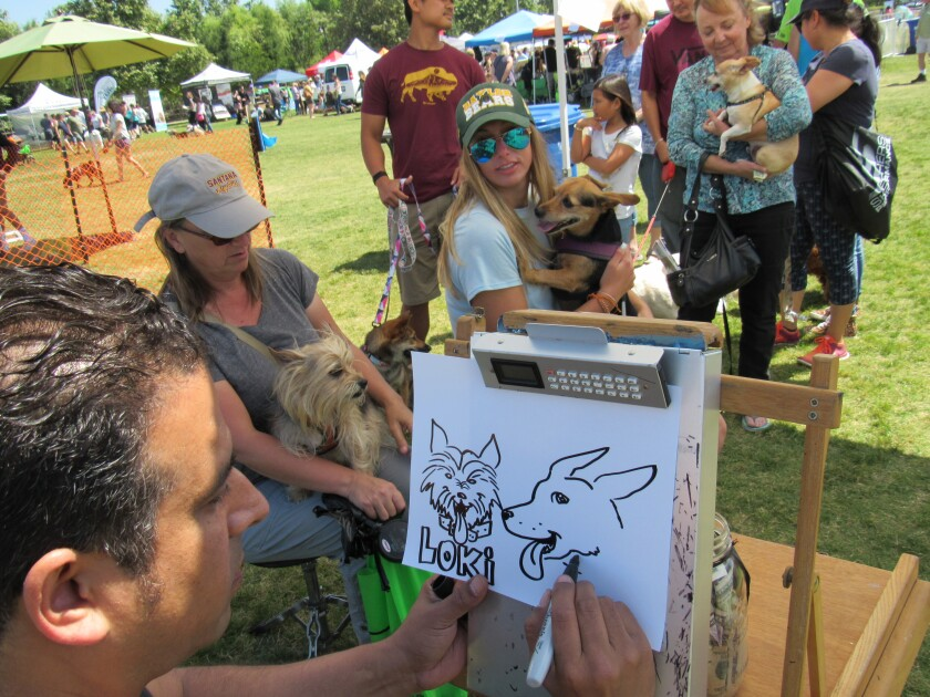 Local artist Crossby Vargas worked on a caricature at Santee's Fido Fest earlier this month. The city just released its proposed operating budget, which the City Council is expected to approve on June 26.
