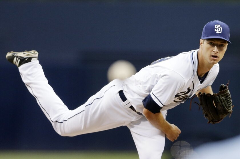 San Diego Padres starting pitcher Colin Rea throws to a Cincinnati Reds batter as he makes his major league debut, during the first inning in a baseball game Tuesday, Aug. 11, 2015, in San Diego. (AP Photo/Gregory Bull)