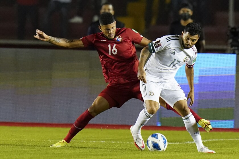 Panama's Andres Andrade battles Mexico's Jesus Corona for possession of the soccer ball.