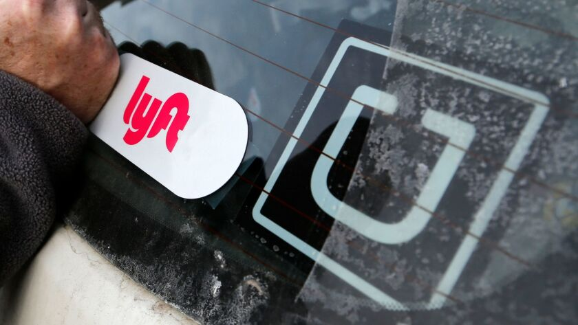 In this Jan. 31, 2018, photo, a Lyft logo is installed on a Lyft driver's car in Pittsburgh. (AP Pho