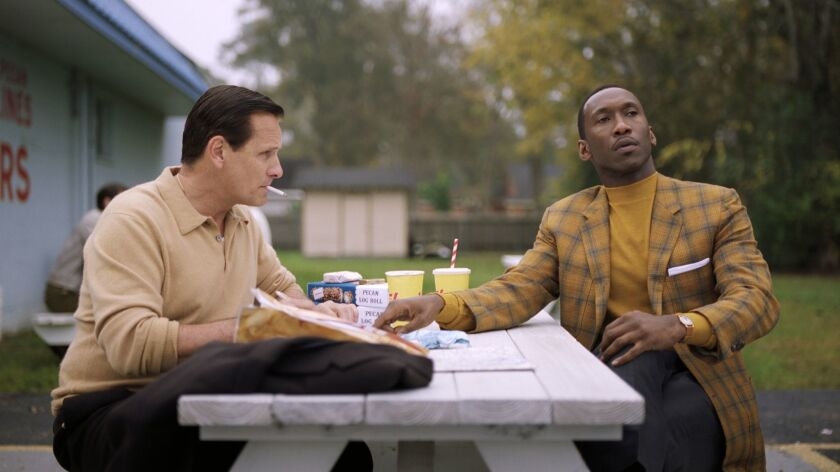This image released by Universal Pictures shows Viggo Mortensen, left, and Mahershala Ali in a scene