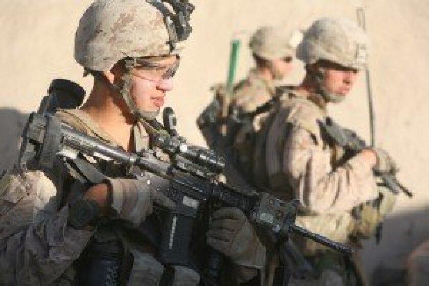 Helmand Province, Afghanistan 2013. Sgt. Bryan Barrow (far left) with Marines. Photo courtesy of Sgt. Bryan Barrow (USMC).