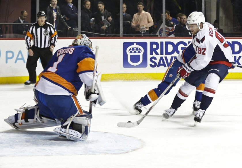 Washington Capitals' Evgeny Kuznetsov (92) attempts to score on New York Islanders goalie Thomas Greiss (1) during the first period of an NHL hockey game Thursday, Feb. 18, 2016, in New York. (AP Photo/Frank Franklin II)