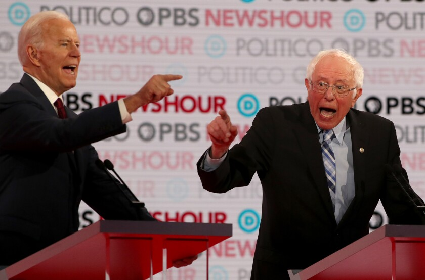 Former Vice President Joe Biden and Sen. Bernie Sanders argue during the Democratic presidential primary debate at Loyola Marymount University on Dec. 19 in Los Angeles.