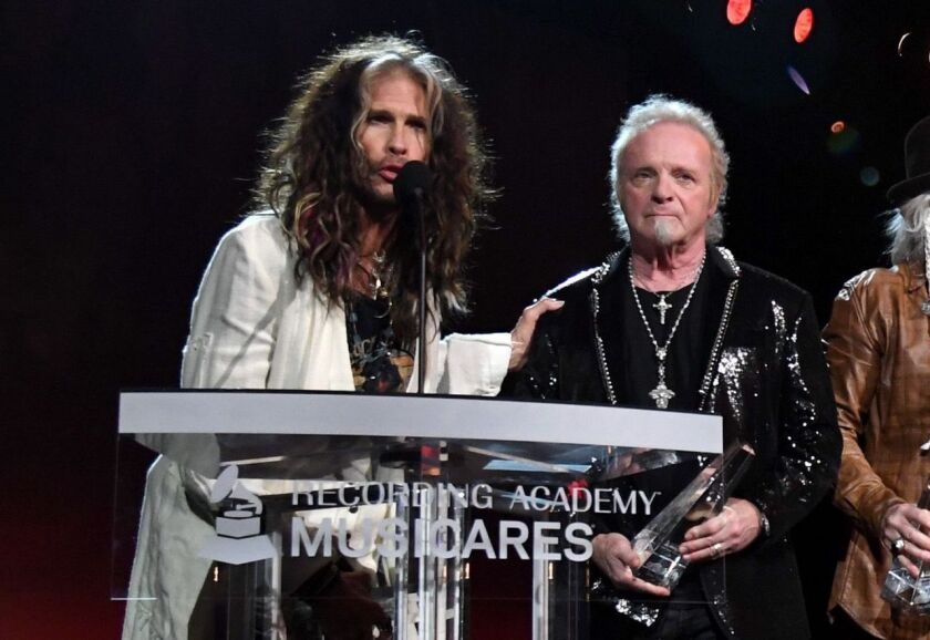 Aerosmith singer Steven Tyler (left) and drummer Joey Kramer briefly reunited to make a few remarks the 2020 MusiCares Person of the Year gala concert. But when the band performed a few minutes later, Kramer was offstage as another drummer performed in his place.