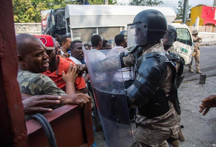 Haitian police block the path of protesters marching in Port-au-Prince on Friday, Nov. 23, to demand the resignation of President Jovenel Moise. EFE-EPA/Estailove ST-VAL