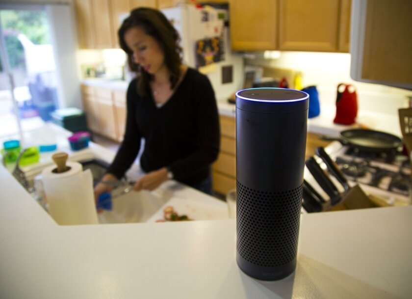 "The Amazon Echo wireless speaker and voice command personal assistant named ""Alexa,"" sits on the counter in Liz Philips' Scripps Ranch home. ""Alexa"" is capable of voice interaction, plays music, makes to-do lists, sets alarms, streams podcasts, plays audiobooks, and gives weather and traffic update"