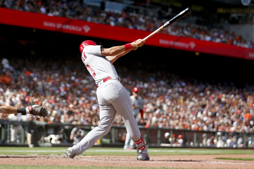 St. Louis Cardinals' Matt Carpenter hits a two-run triple against the San Francisco Giants during the seventh inning of a baseball game in San Francisco, Monday, July 5, 2021. (AP Photo/Jed Jacobsohn)