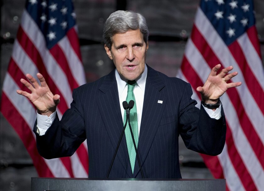 """Secretary of State John Kerry speaks at the """"SelectUSA Investment Summit,"""" Friday, Nov. 1, 2013, in Washington. Kerry urged business leaders from around the world to bring their business to, and invest in the United States. (AP Photo/ Evan Vucci)"""
