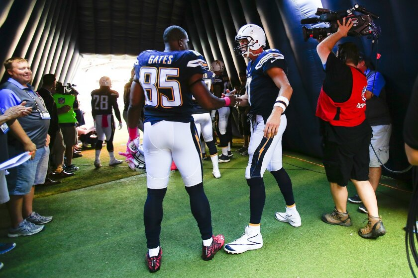 Chargers Philip Rivers shakes the hand of Antonio Gates as returns back to football just in time to take the field against the Steelers at Qualcomm Stadium. (Nelvin C. Cepeda / San Diego Union-Tribune)