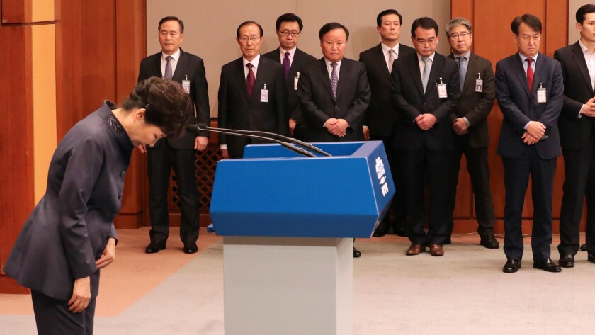 South Korean President Park Geun-hye bows after a public apology in Seoul.