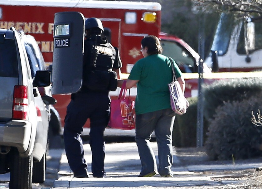 Phoenix office shooting: Manhunt continues, one person dead