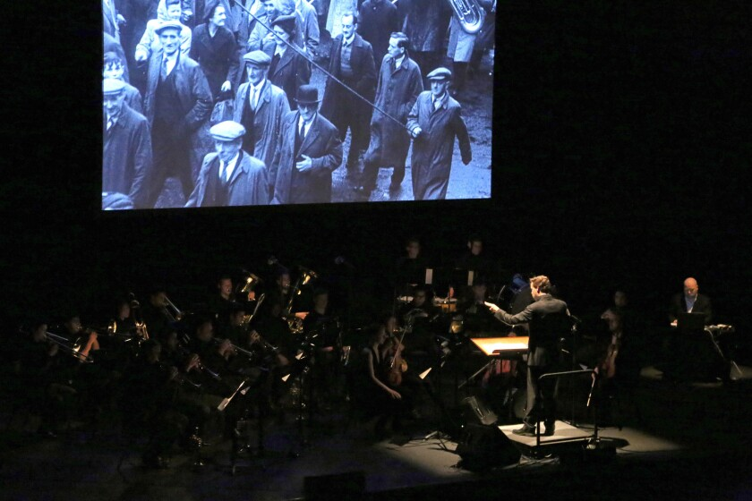 """Bill Morrison's """"The Miners' Hymns,"""" a documentary about coal workers in northeast England last century, rolls as Ryan McAdams conducts the score at Royce Hall."""