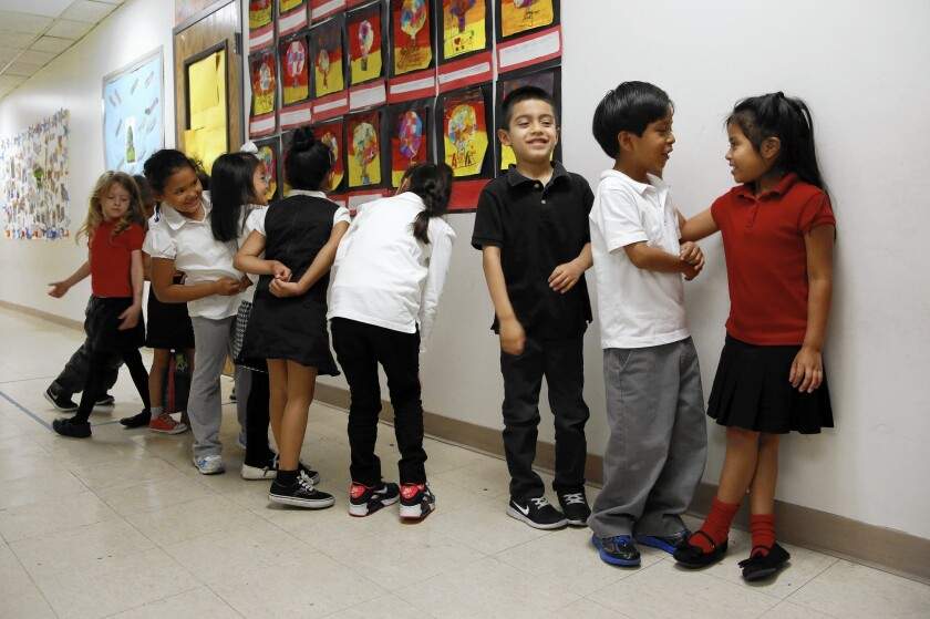 Kindergarten students line up for lunch at Metro Charter Elementary in downtown Los Angeles.