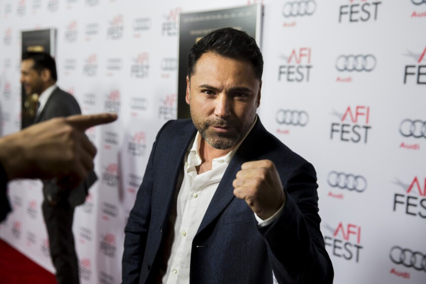 """Oscar De La Hoya, poses for photos on the red carpet before the premiere of """"33,"""" at AFI FEST 2015 in Hollywood."""