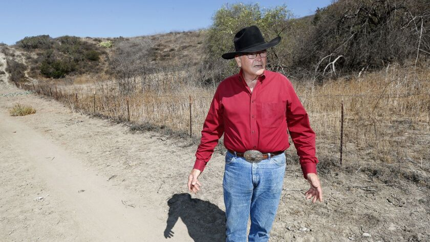 "Frank Fitzpatrick, 70, speaks during an interview at ""The Ranch,"" an 800 acre pasture he manages in"
