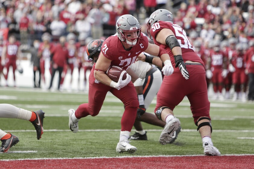 Washington State running back Max Borghi (21) runs for a touchdown during the second half of an NCAA college football game against Oregon State, Saturday, Oct. 9, 2021, in Pullman, Wash. Washington State won 31-24. (AP Photo/Young Kwak)