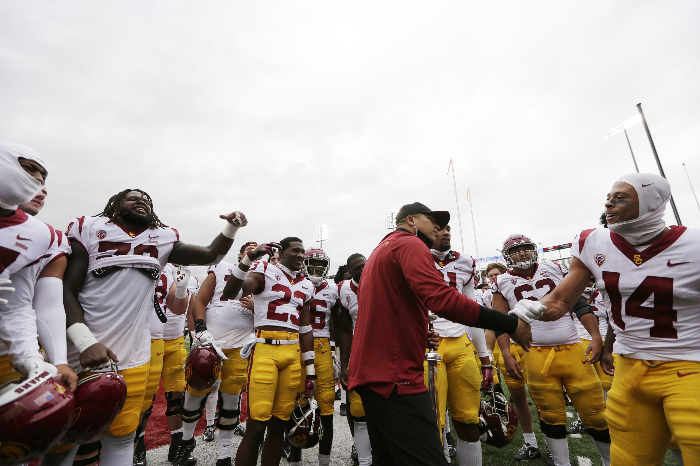 Donte Williams shakes hands with USC players after a win