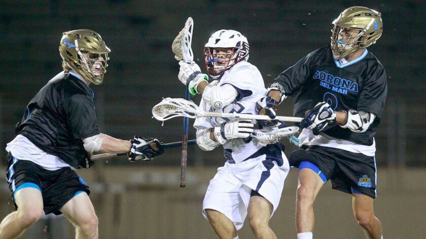 NEWPORT BEACH, CA, March 27, 2015 -- Newport Harbor High's Adrian Jouglet, center, battles against C