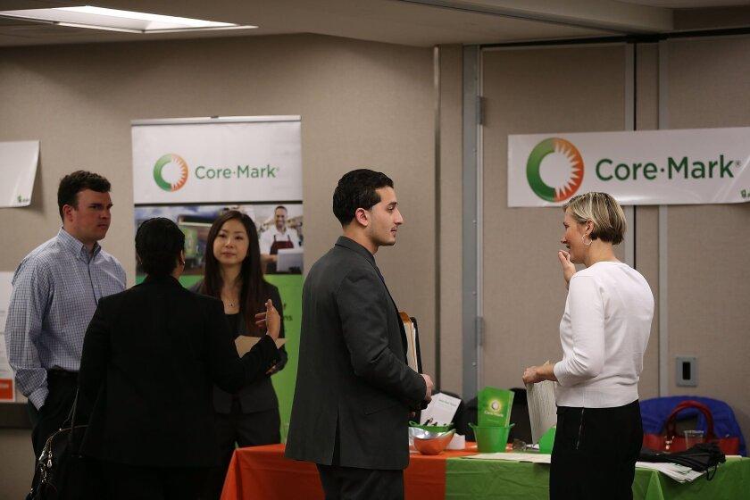 Job seekers meet with recruiters during a June 4 career fair in San Francisco.