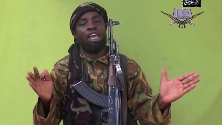 Boko Haram leader Abubakar Shekau, here in a file photo taken from video, remains elusive, but Nigerian authorities say they captured 167 Boko Haram fighters, along with women and children.