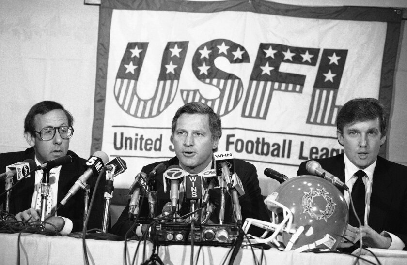FILE - In this Aug. 2, 1985, file photo, Donald Trump, right, New York real estate magnates Stephen Ross, left, and USFL Commissioner Harry L. Usher, center, participate in a news conference in New York to discuss the agreement they have reached in principle to merge the Houston Gamblers and New Je