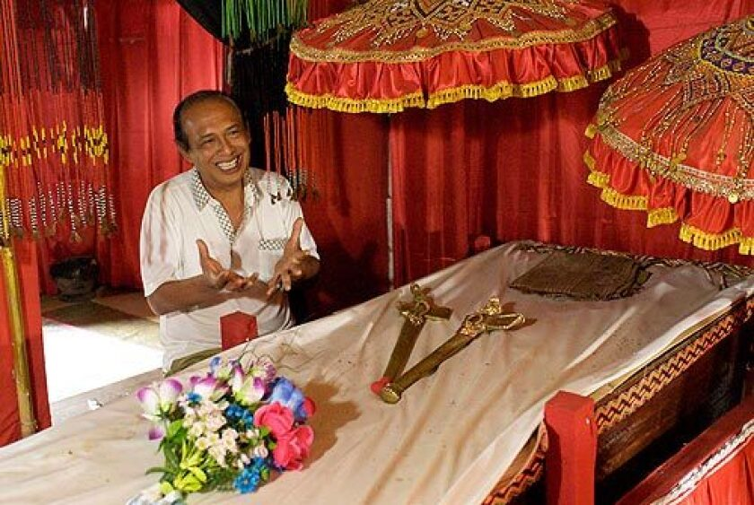 The mummy of the last king of Toraja, Puang Sambolinggi, has waited in this coffin for five years while the king's son, Eddy Sambolinggi, 56, and other family members negotiate details of the late monarch's elaborate funeral. More photos >>>