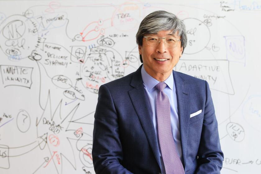 Dr. Patrick Soon-Shiong at NantWorks in Culver City, in front of a whiteboard with cancer-related brainstorming, is the new owner of The San Diego Union-Tribune, Los Angeles Times and a string of community publications (including La Jolla Light) in Southern California.