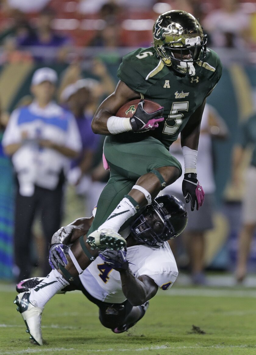 South Florida running back Marlon Mack (5) eludes East Carolina defensive back Detric Allen (4) to score a touchdown during the second quarter of an NCAA college football game, Saturday, Oct. 11, 2014, in Tampa, Fla. (AP Photo/Chris O'Meara)
