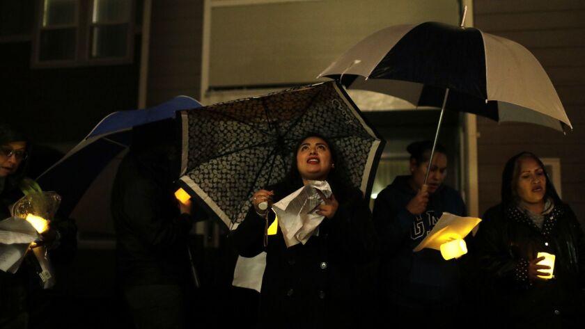 SANTA CRUZ, CA-DECEMBER 16, 2018: Gabriela Cruz, center, sings during a posada she helped organize a
