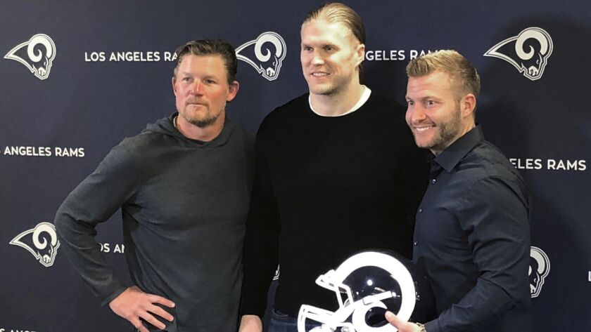 Los Angeles Rams linebacker Clay Matthews, center, stands with general manager Les Snead, left, and
