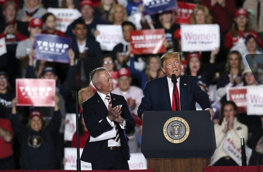 President Trump, joined by Rep. Jefferson Van Drew (R-N.J.), speaks during a campaign rally Jan. 28 in Wildwood, N.J.