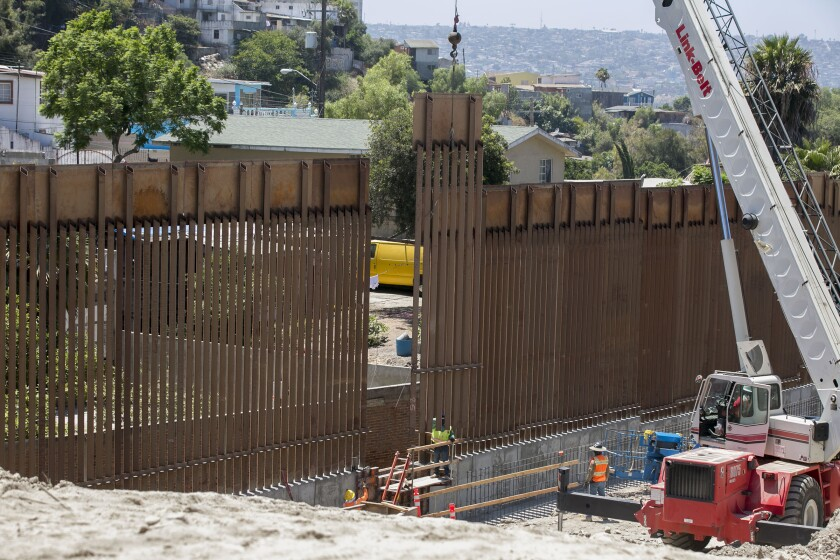 Crews moved the last panel in the 14-mile $147 million primary fence replacement project into place on Friday, August 9, 2019 just east of the San Ysidro Port of Entry.