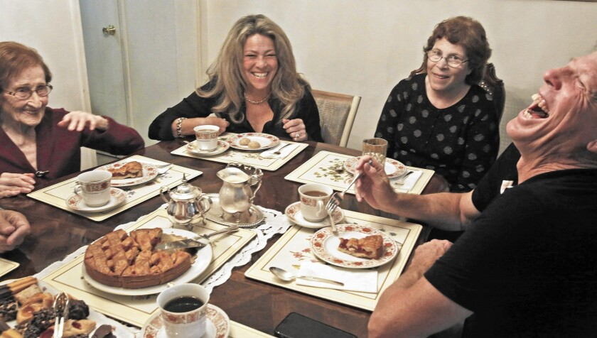 """From left, Ludmila Page, 95, shares memories about the Holocaust with Mona Shafer Edwards, Marie Knecht (Page's daughter) and Martin Shafer during a meeting of their """"kindergarten coffee"""" club at Page's Beverly Hills home on Oct. 28, 2015."""