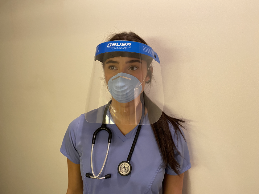 Brooke Macri, a nurse at the Elliot Hospital in Manchester, N.H., wears a Bauer face shield.