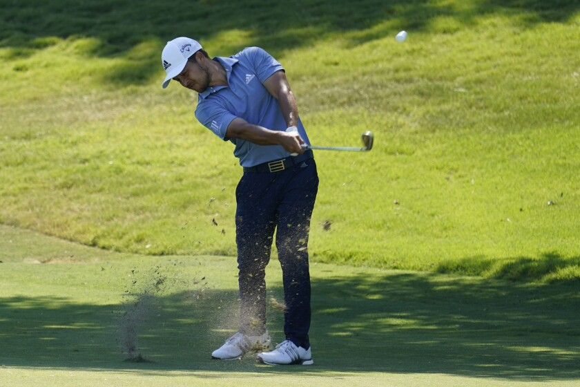 Xander Schauffele hits his second shot on No. 18 at the Charles Schwab Challenge in Fort Worth on June 13, 2020.