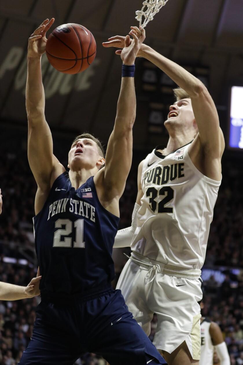 Purdue center Matt Haarms (32) blocks the shot of Penn State forward John Harrar (21) during the first half of an NCAA college basketball game in West Lafayette, Ind., Tuesday, Feb. 11, 2020. (AP Photo/Michael Conroy)